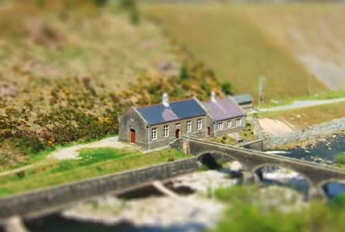 Cottage by a bridge